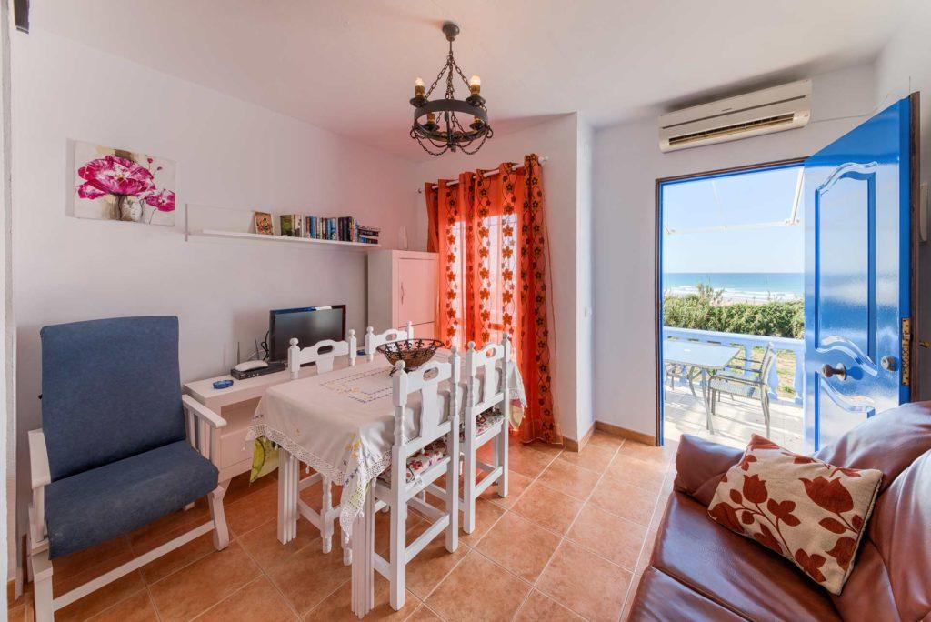 Apartamento Huerto - Salón - Apartamentos Patio Andaluz - Playa de La Fontanilla (Conil)